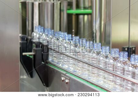 The Plastic Bottle In The Conveyor Belt At The Water Drinking Factory