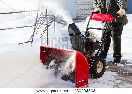 A Snowplow Clears The Road To The Plot