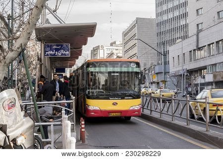 Tehran, Iran - March 8, 2018 Tehran Cityscape, Brt Buses Driving Through Allocated Lines In Vali-asr