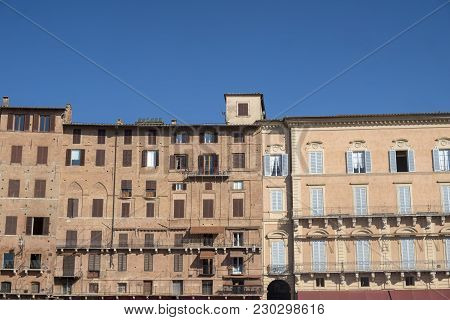 Historic Buildings In Piazza Del Campo In Siena, Tuscany, Italy, The Famous Square Hosting The Palio