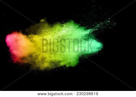 The Explosion Of Multi Colored Powder. Beautiful Rainbow Color Powder Fly Away. The Cloud Of Glowing