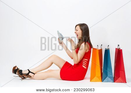Beautiful Glamour Fashionable Young Woman In Red Dress Sitting With Cash Dollars, Multi Colored Pack