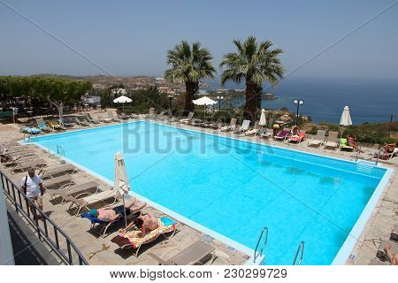 Agia Pelagia, Greece - May 18, 2013: People Relax By A Swimming Pool In A Generic Resort In Agia Pel