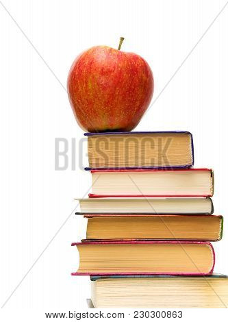 Red Apple On Pile Of Books Closeup On White Background.horizontal Photo.