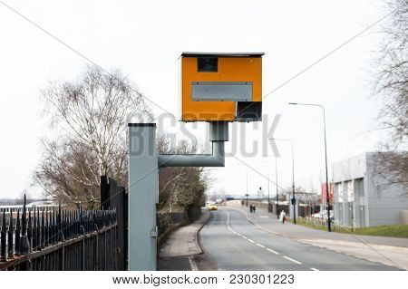 A Speed Camera Set Up Next To A Fast Stretch Of Road