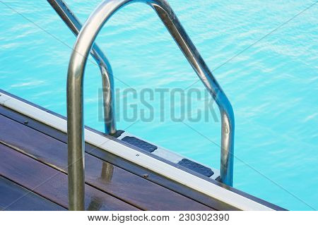 Handrails For Descent Into The Pool. Pool Cleaner During His Work