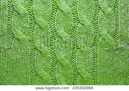 Green Knit Texture of Green Wool Knitted Fabric with Cable Knits Pattern. Blank Background