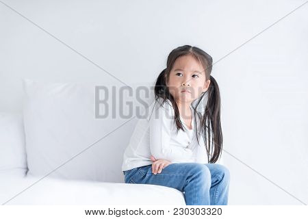 Lonely Kid Is Sitting Alone At The Morning In Bedroom.