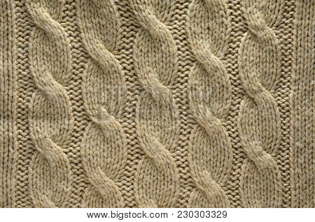 Knit Texture of Beige Wool Knitted Fabric with Cable Knits Pattern. Blank Background