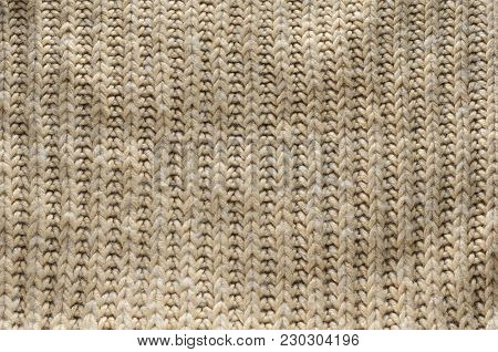 Knit texture of wool knitted fabric with regular pattern as background