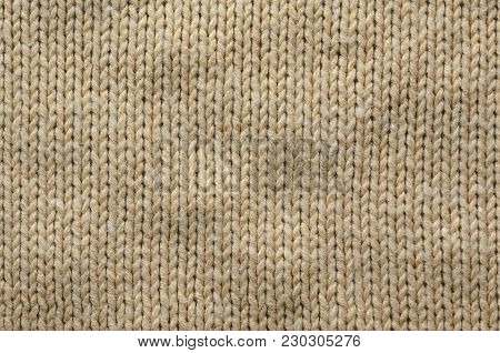 Knit Texture of Beige Wool Knitted Fabric with Regular Pattern. Knit Sweater Blank Background