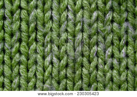 Green Knit Texture Close-Up. Knit Sweater Blank Background