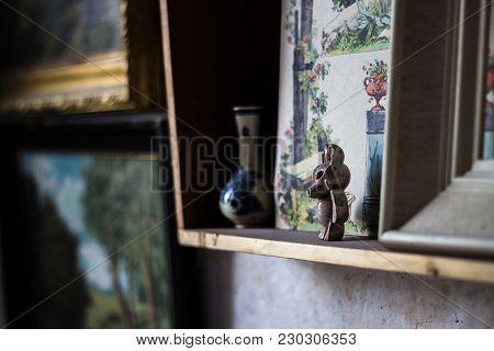 Little Brown Ceramic Rabbit On A Vintage Frame