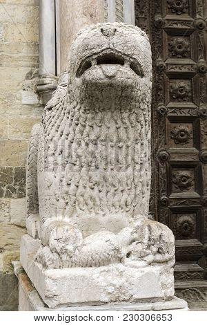 Lion Statue In Front Of Parma Cathedral, Italy. Statue Was Made By Giambono Da Bissono In 1281.