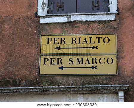 Venice Italy Road Sign With Indication To Railto Bridge Or Saint Mark Square With Two Black Arrows
