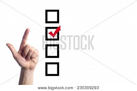 The Hand Of The Person Chooses And Puts A Tick, The Person At Elections. Choosing One With Four Opti