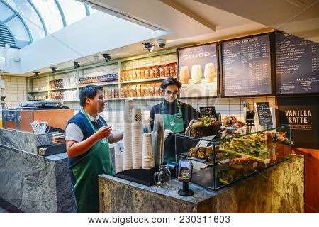 London, Uk - March 8, 2018: Two Southeast Asian Baristas At A Starbucks Coffee House In High Street