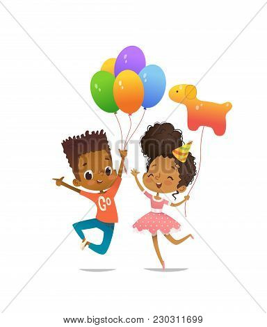 Joyous African-american Boy And Girl With The Balloons And Birthday Hat Happily Jumping With Their H