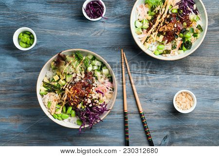 Poke Bowl With Chopsticks And Ingredients. Poke Is A Traditional Hawaiian Dish Influenced By Japanes