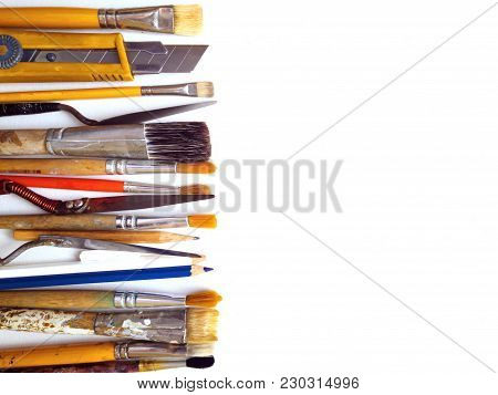 Artistic Brushes In A Row Close - Up On Canvas. Professional Artist's Tool. The View From The Top. C