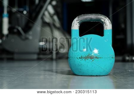 Old Heavy Used Blue Kettle Bell On The Gym Floor Ready For Hard Core Strength And Conditioning Worko