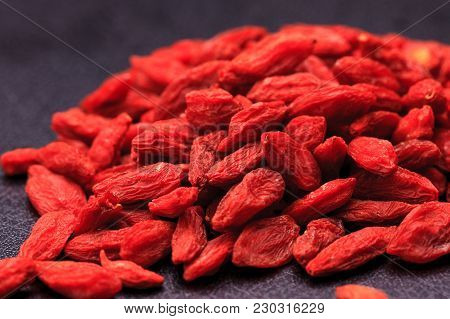 A Pile Of Goji Berries Otherwise Known As Wolfberries Originally From China.