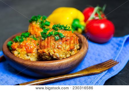 Meatballs With Rice And Meat In A Wooden Dish. Place For Your Text...