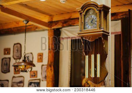 Antiquarian Wooden Clock With A Pendulum