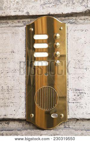 The Brass Intercom On Marble Facade Close Up