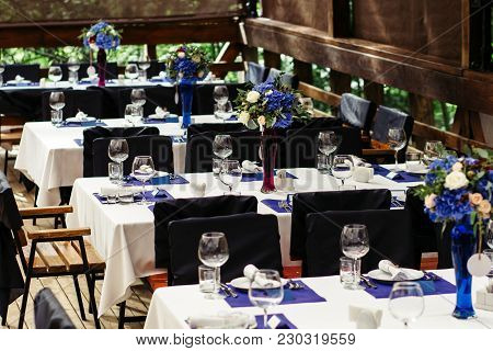 Flower Arrangement On Wedding Table, Richly Decorated With Beautiful Floral Bouquets. Floral Composi