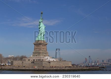 Statue Of Liberty And New York Skyline