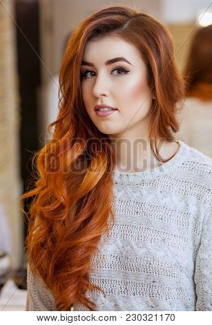 Portrait Of A Beautiful, Red-haired Girl With Long Hair In A Beauty Salon. Professional Hair Care An