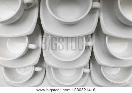 Many Rows Clean White Coffee Cup, Tea Spoon And Saucer On Table. Empty Mug Set In Row Prepare For Co