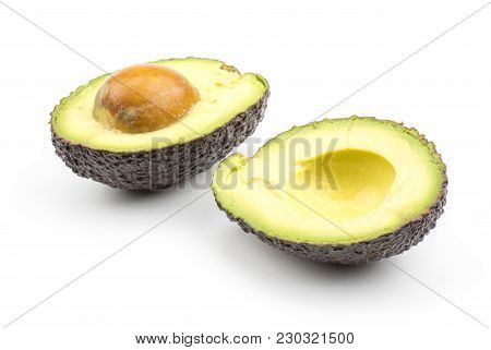 Sliced Green Brown Avocado Isolated On White Background Two Ripe Alligator Pear Halves With A Seed