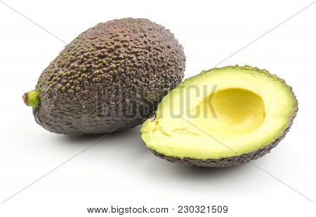 One Avocado And A Half Without Seed Isolated On White Background Ripe Green Brown Alligator Pear