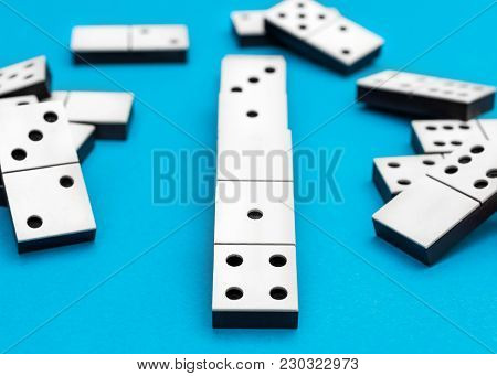 Domino's Pieces On A Blue Background.