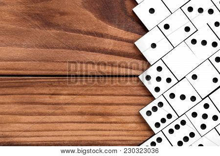 Dominoes On Wooden Background. Top View. Frame. Copy Space For Text.