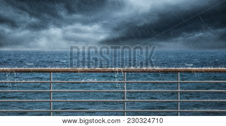 Railing At The Sea And Much Rain
