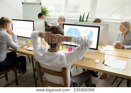 Male Employee Analyzing Statistics Data Charts Preparing Report Sharing Office Desk With Diverse Col