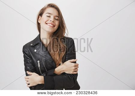 Look At That Beauty And Youth. Portrait Of Modern Attractive Feminine Woman Holding Herself With Cro