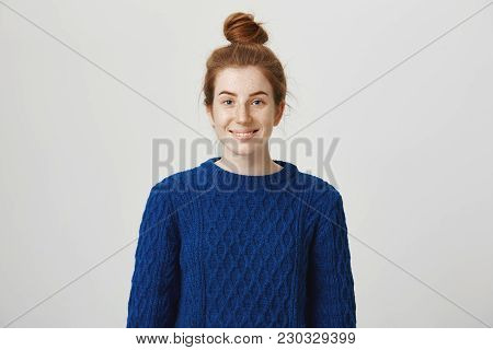 Let Us Be Friends. Portrait Of Sincere Good-looking Ginger Girl With Bun Hairstyle And Freckles Wear