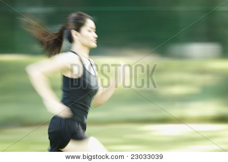 Asian Woman Running. Blurred By Motion