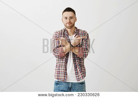 Confused And Puzzled Good-looking Man With Beard, Pointing Sideways, Hesitating And Not Knowing Whic