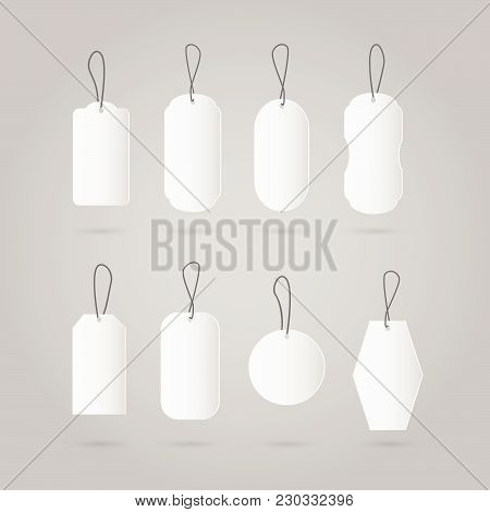 Illustration Of Various White Tags Against A Gray Background.