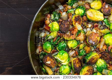 Cast Iron Skillet With Brussels Sprouts With Sliver Of Table Background