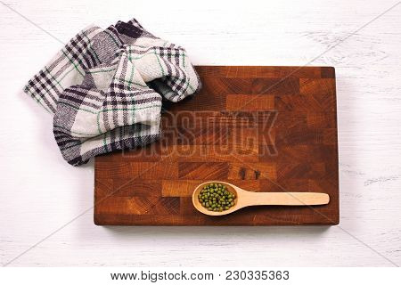 Rustic Wooden Board, Checkered Napkin And Lentils Seeds With Copy Space For Your Menu Or Recipe. Men