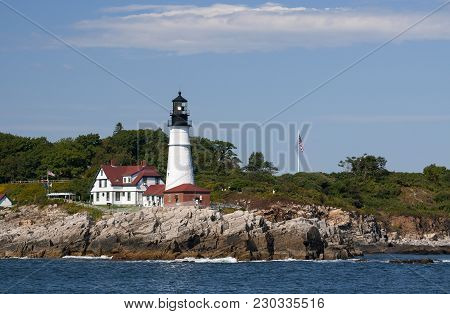 Portland Head Lighthouse Displays Bright Light On Warm Summer Day In Maine.