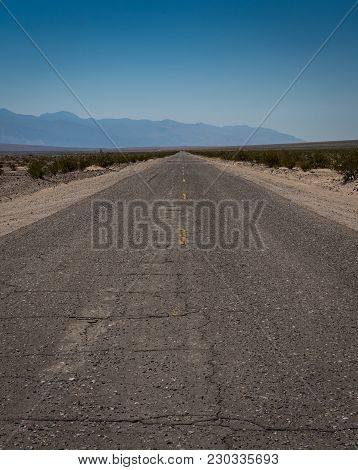 Cracking Desert Road On Hot Day In Death Valley