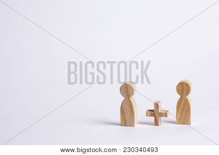 Two People With A Plus In Between. Wooden Figures Of Persons. Friends, Relatives, Lovers. Social Mat