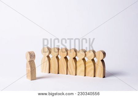 People Stand In Line At The Briefing And Wait For Orders. Wooden Figures Of People Are Waiting In Li